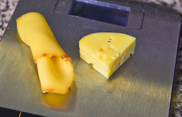 large chunks of cheese on the scales closeup .