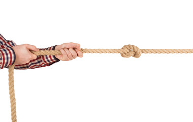 man pulling a rope, isolated on white