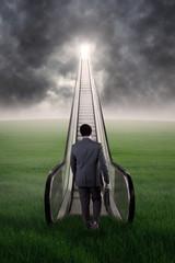Man walking toward success door at sky
