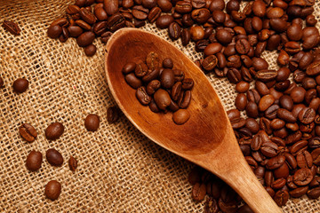 Coffee beans and wooden spoon