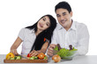 Vegetarian couple with fresh vegetables
