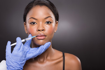 afro american woman receiving cosmetic injection