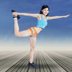 Woman posing on balance exercise