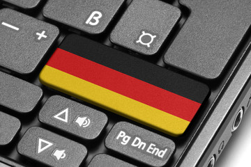 Go to Germany! Computer keyboard with flag key.