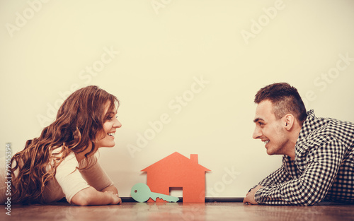 Couple lying on floor daydreaming at home - 79055394