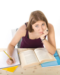 student girl studying for exam in stress tired and bored