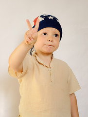 Little Boy with Bonnet Showing Peace Hand Sign
