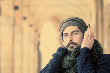 young stylish bearded man with headphones in instagram tone