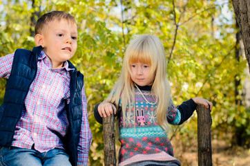 Cute Little Kids in Autumn Fashion at the Garden