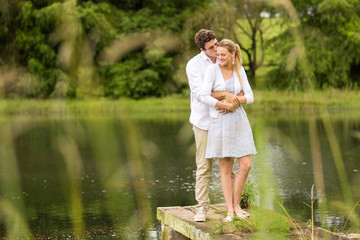 young couple standing by the river