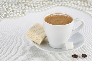 cup of coffee on a white wicker a mat