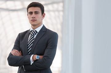 Portrait of handsome confident young businessman