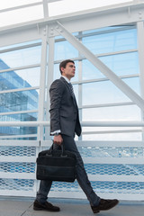 Businessman walking in urban environment of airport or office bu
