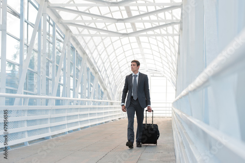 Leinwandbild Motiv Businessman walking in urban environment of airport