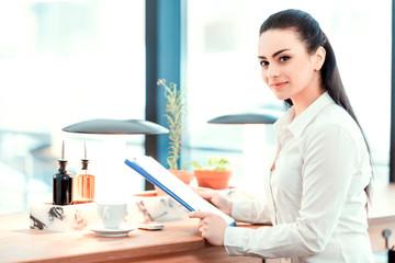 Beautiful young woman having business lunch