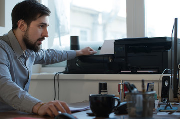 Businessman scanning and printing document