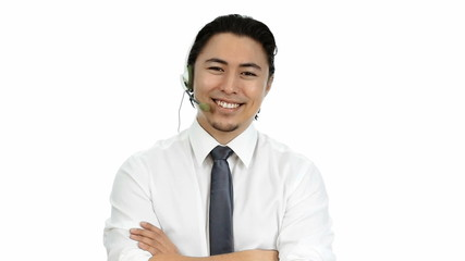 Attractive businessman standing wearing a headset
