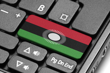 Go to Malawi! Computer keyboard with flag key.