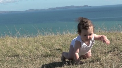 Slow motion Baby girl crawling outdoors