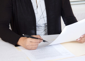 Business person reading financial documents
