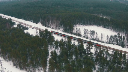 Flying Above Winter Forest and Railroad, aerial view