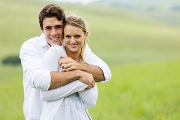 young couple portrait on grassland