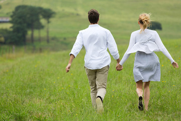 couple running on a green field