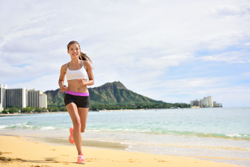 Sport running fitness woman jogging on beach run
