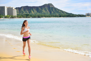 Runner - Sport running fitness woman beach jogging