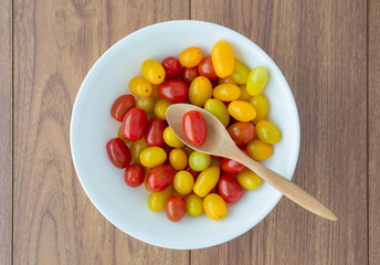 red and yellow tomatoes with a spoon