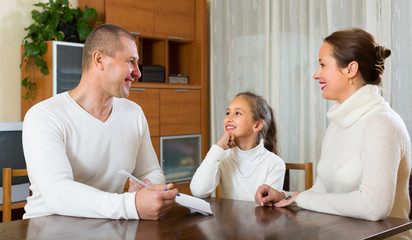 Father and daughter complete a questionnaire