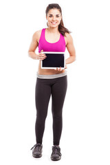 Athletic woman with a tablet