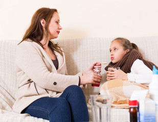 Woman caring for sick daughter