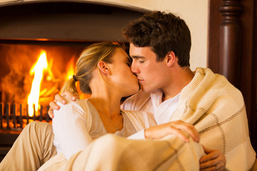 young couple kissing at home