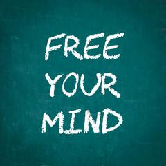 FREE YOUR MIND written on chalkboard