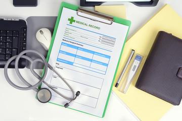 Medical record on desk.