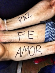 spanish positive words written on arms