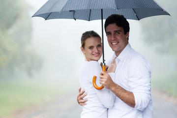 couple holding an umbrella