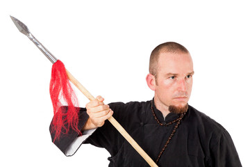 Martial arts teacher with spear in defensive pose