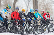 cyclists on start in the winter