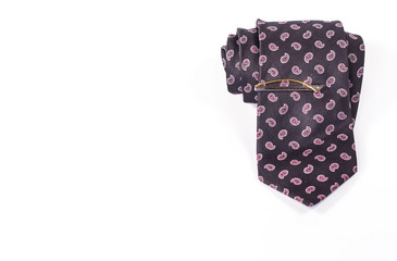 tie roll with tie clip isolated on white background.