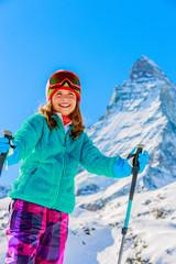 Ski, winter vacation, snow - girl enjoying ski vacations