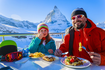 Winter, ski - skiers enjoying break for lunch