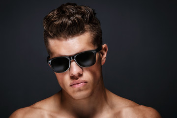 Portrait of awesome male in sun glases.