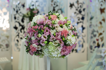 Festive bouquet of flowers at the wedding table decoration