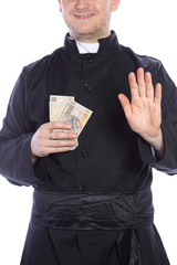 The young priest holding a lot of money in hand