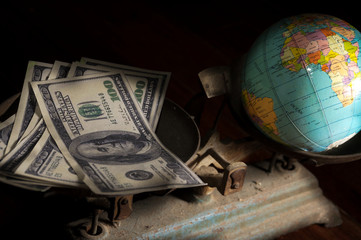 Balancing with money and earth.