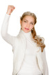 Exited young woman raising clenched fist arm
