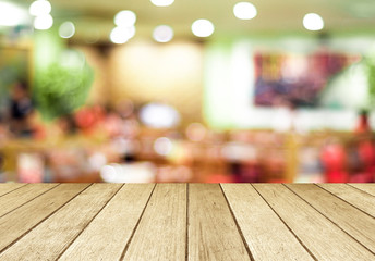 Perspective wood and blurred cafe with bokeh light background