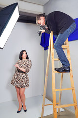 Photo shooting the model in the studio.